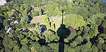 View over trees of Het Park with shadow of the 185 metre tall Euromast tower, Rotterdam, Netherlands