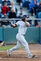 Kyle Von Tungeln #14 of the Tri-City Dust Devils bats against the Everett AquaSox at Everett Memorial Stadium on July 23, 2013 in Everett, Washington. Everett defeated Tri-City, 3-2. (Larry Goren/Four Seam Images)