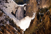 Lower Falls cascades into the Grand Canyon of the Yellowstone River in Yellowstone National Park.