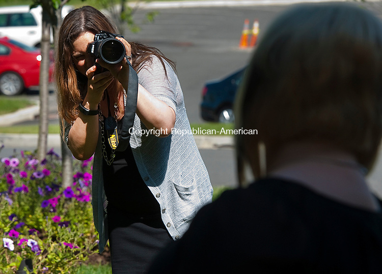 PROSPECT, CT--060715JS14-   Photographer Stacey McCarthy of Southington, photographs a guest during a wedding Sunday at Aria Wedding &amp; Banquet Facility<br /> Jim Shannon Republican-American