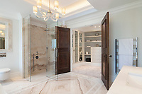 BNPS.co.uk (01202 558833)<br /> Pic: Savills/BNPS<br /> <br /> One of six bathrooms.<br /> <br /> Fairway to Heaven - Hills End has been described as 'a fabulous new masterpiece'. <br /> <br /> This breathtaking brand new mansion only a pitching wedge from one the most exclusive golf clubs in the country has emerged for sale for a whopping £22m.<br /> <br /> Hills End nestles within the prestigious Sunningdale estate in Surrey, home of the £4,000 a year Sunningdale Golf Club which dates back to 1900 and has hosted the Women's British Open and the Senior Open Championship.<br /> <br /> The newly-built property sits on a 1.75 acre plot  boasting six bedrooms, eight reception areas, a swimming pool complex with spa, sauna and yoga rooms along with a large cinema. and walk in wardrobes.<br /> <br /> The incredible Palladian style home is on the market with estate agents Savills who describe it as 'a fabulous new masterpiece'...that comes with a whopping £22 million price tag.