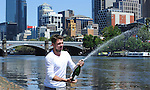 Stanislaus Wawrinka shows off with a little bubbly, after clinching the men's title in Melbourne, Australia on January 26, 2014 by defeating Rafael Nadal.