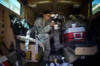 US ARMY Specialist Kahaya Komar eats lunch while her truck stopped at an american base during  a day long logistical mission between Jalalabad and The Pech Valley in Kunar province, Afghanistan on Wednesday  May 1, 2010...Specialist Komar is a radio operator and assistant gunner on logistical convoys with Destro Platoon, Fury Company, 2nd Battalion, 4th Brigade, Task Force Mountain Warrior, 4th Infantry Division..