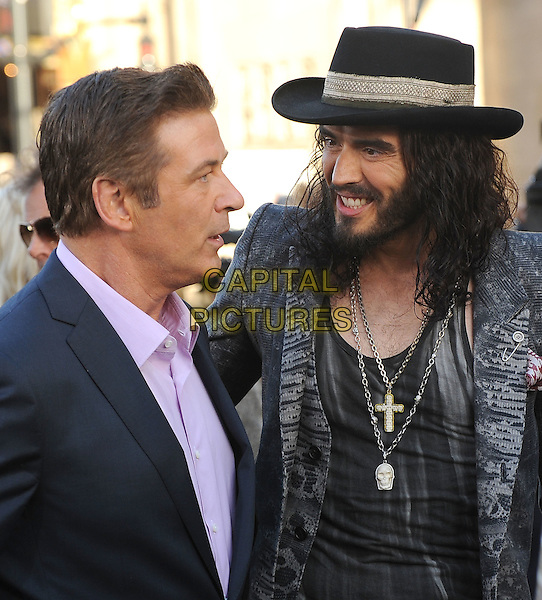"Alec Baldwin, Russell Brand.The Los Angeles Premiere of ""Rock Of Ages"" at Grauman's Chinese Theatre in Hollywood, California, USA..June 8th, 2012.half length suit top pink shirt black jacket hat beard facial hair necklaces profile grey gray.CAP/ROT/TM.©Tony Michaels/Roth Stock/Capital Pictures"