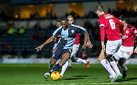 Anthony Stewart of Wycombe Wanderers takes on defenders during the Sky Bet League 2 match between Wycombe Wanderers and Crawley Town at Adams Park, High Wycombe, England on 28 December 2015. Photo by Andy Rowland / PRiME Media Images