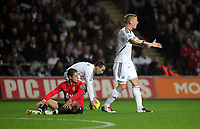 Pictured: Garry Monk of Swansea (R) protesting to the match referee for his decision to award a foul against Patrice Evra of Manchester United (L). Saturday 19 November 2011<br />