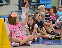 NWA Democrat-Gazette/BEN GOFF &bull; @NWABENGOFF<br /> Milani Weaver, 6, (left) and Katelyn Nguyen, 5, share a laugh after Weaver was given the 'golden spoon' to hold, a reward for good behavior in the cafeteria, on Monday Aug. 3, 2015 as Natalie Marts' Kindergarten class learns how to go through the lunch line during the first day of school at R.E. Baker Elementary in Bentonville. Baker and Elm Tree elementary schools in Bentonville run on a nontraditional calendar. Monday was also Weaver's birthday.