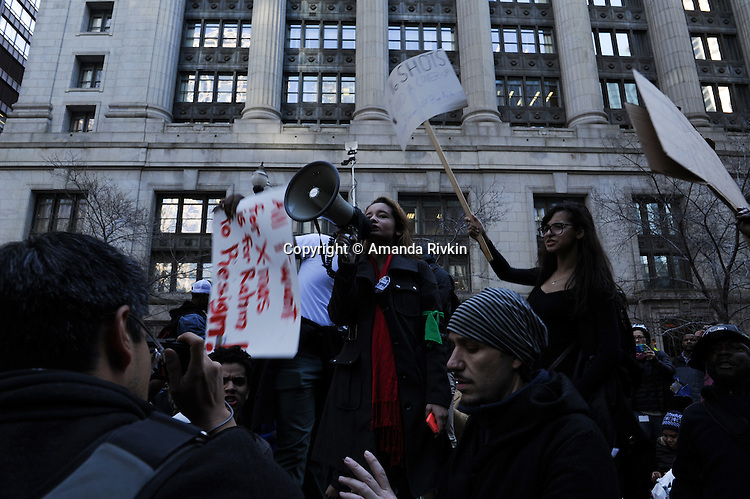 Protesters calling on Chicago Mayor Rahm Emanuel to resign in front of the State of Illinois building in the Loop in Chicago, Illinois on December 9, 2015.  Emanuel offered a historic apology for the police killing of Laquan McDonald and police brutality and racial profiling generally -- without using those words -- in front of the City Council in the morning.