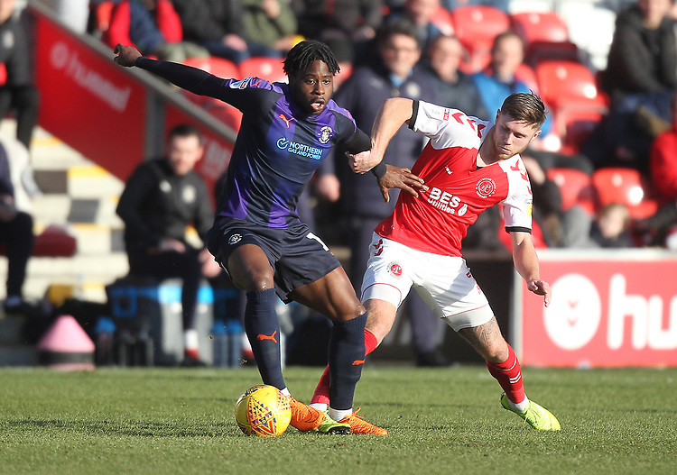 Fleetwood Town's Wes Burns  in action with Luton Town's Pelly Ruddock <br /> <br /> Photographer Mick Walker/CameraSport<br /> <br /> The EFL Sky Bet League One - Fleetwood Town v Luton Town - Saturday 16th February 2019 - Highbury Stadium - Fleetwood<br /> <br /> World Copyright © 2019 CameraSport. All rights reserved. 43 Linden Ave. Countesthorpe. Leicester. England. LE8 5PG - Tel: +44 (0) 116 277 4147 - admin@camerasport.com - www.camerasport.com