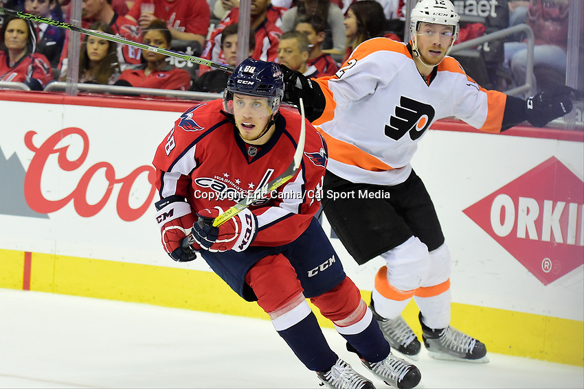 Friday, April 22, 2016: Washington Capitals defenseman Nate Schmidt (88) and Philadelphia Flyers left wing Michael Raffl (12) in game action during game 5 of the first round of the National Hockey League Eastern Conference playoffs  between the Philadelphia Flyers and the Washington Capitals held at the Verizon Center in Washington, DC. The Flyers defeat the Capitals 2-0. Eric Canha/CSM