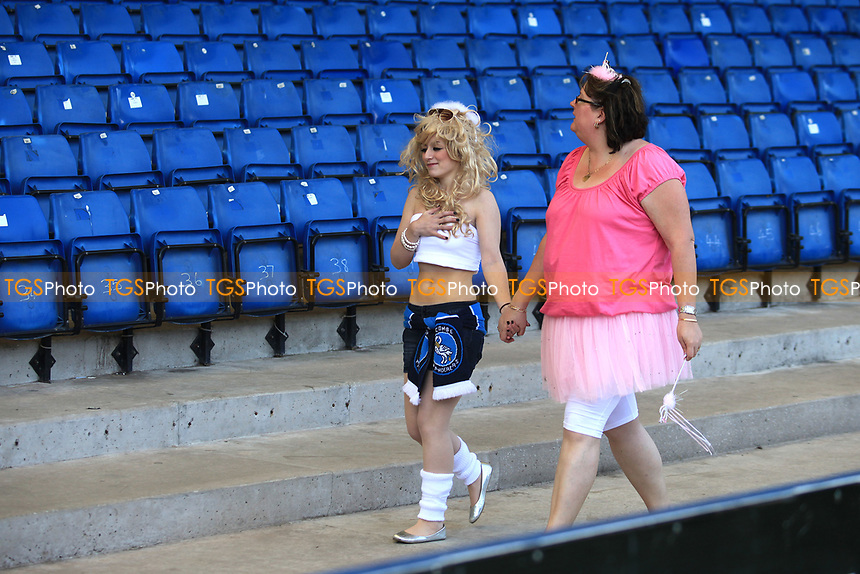 Last away day of the season often means supporters wear their fancy dress outfits. A couple of Wycombe fans arrive at he ground ahead of kick-off during Bury vs Wycombe Wanderers, NPower League Two Football at Gigg Lane on 30th April 2011
