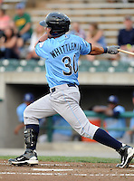 Infielder John Whittleman (30) of the Wilmington Blue Rocks, Carolina League affiliate of the Kansas City Royals, in a game against the Lynchburg Hillcats on June 15, 2011, at City Stadium in Lynchburg, Va. (Tom Priddy/Four Seam Images)
