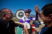 Mario Gutierrez celebrates a victory in the 2012 Santa Anita Derby at Santa Anita Park in Arcadia California on April 7, 2012.