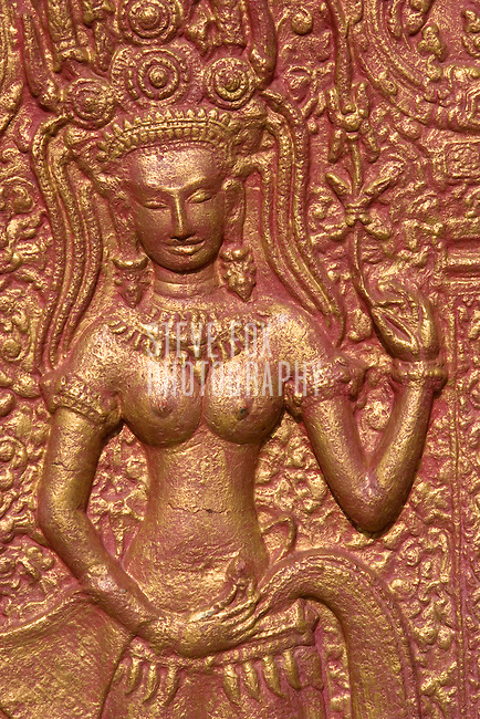 Carving detail showing a female, Wat Phnom, Phnom Penh, Cambodia