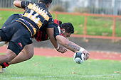 Taafaga Tagaloa dives over to score for Papakura. Counties Manukau Premier Club Rugby game between Papakura and Bombay, played at Massey Park Papakura on Saturday June 16th 2018. Bombay won the game 36 - 17 after leading 17 - 7 at halftime.<br /> Papakura Ray White 17 - Kris Smithson 2, Taafaga Tagaloa tries, Monty Punatai conversion.<br /> Bombay 36 - Jordan Goldsmith, Haamiora Clarke 2, Patrick Masoe, Mitchell Thackham, Chay Mackwood tries, Jordan Goldsmith 2, Ki<br /> Anufe conversions.<br /> Photo by Richard Spranger.
