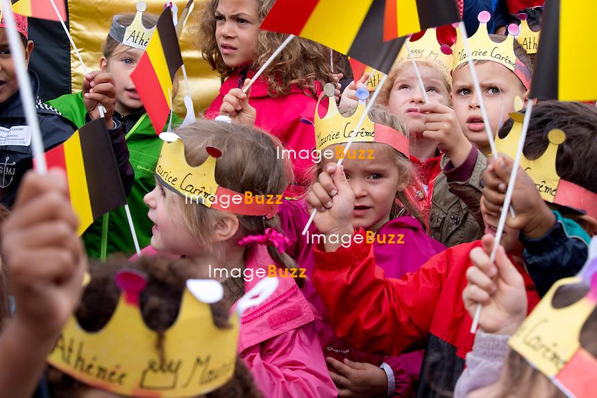 King Philippe of Belgium &amp; Queen Mathilde of Belgium  make their second visit to the city of Wavre to celebrate their  'Joyous Entry '. Belgium, September 10, 2013.<br /> <br /> .Le roi Philippe de Belgique et la reine Mathilde de Belgique en visite dans la ville de Wavre  ,la Cit&eacute; du Marca chef-lieu du Brabant Wallon, pour leur &quot; Joyeuse Entr&eacute;e &quot;.<br /> Le couple royal a &eacute;t&eacute; re&ccedil;u par les autorit&eacute;s locales et provinciales vers 11 heures Le couple royal est arriv&eacute; &agrave; 11h00 devant le Palais provincial o&ugrave; es jeunes &eacute;l&egrave;ves de l'Institut de la Providence, coiff&eacute;s d'une couronne en papier et munis de drapeaux noir-jaune-rouge, ont entonn&eacute; &quot;Vive Mathilde, vive Philippe&quot; sur l'air de &quot;Fr&egrave;re Jacques&quot;.