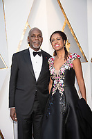 Danny Glover and Eliane Cavalleiro arrive on the red carpet of The 90th Oscars&reg; at the Dolby&reg; Theatre in Hollywood, CA on Sunday, March 4, 2018.<br /> *Editorial Use Only*<br /> CAP/PLF/AMPAS<br /> Supplied by Capital Pictures