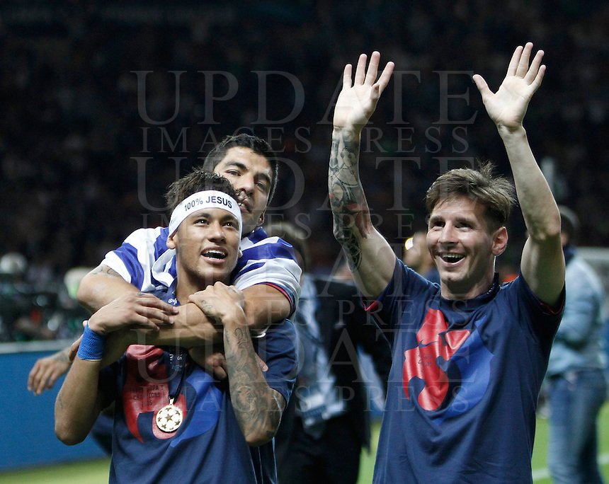Calcio, finale di Champions League Juventus vs Barcellona all'Olympiastadion di Berlino, 6 giugno 2015.<br /> From left, FC Barcelona's stars Neymar, Luis Suarez and Lionel Messi celebrate at the end of the Champions League football final between Juventus Turin and FC Barcelona, at Berlin's Olympiastadion, 6 June 2015. Barcelona won 3-1.<br /> UPDATE IMAGES PRESS/Isabella Bonotto