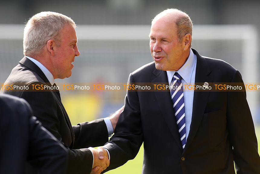 Portsmouth FC Owner, Michael Eiser shakes hands with Portsmouth Manager, Kenny Jackett, ahead of kick-off during AFC Wimbledon vs Portsmouth, Sky Bet EFL League 1 Football at the Cherry Red Records Stadium on 13th October 2018