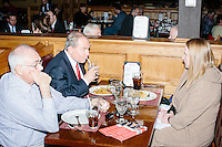 Former Virginia governor and Republican presidential candidate Jim Gilmore gets lunch with brother-in-law Lloyd Gatling, of Suffolk, Virginia, and NH state campaign director Anne Smith, at the Puritan Backroom in Manchester, New Hampshire, on the day of primary voting, Feb. 9, 2016. The Puritan Backroom is a long-time favorite stop of political candidates in the state and place where journalists and political junkies hang out on election days hoping to meet candidates. Gilmore finished in last place among major Republican candidates still in the race with a total of 150 votes.