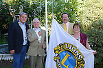 07/06/2013 - The District Governor of Lions Clubs International, Joe Smith, raises the Lions Club flag at the Drogheda Lions Club Charter Night in Scholar's Townhouse Hotel on Friday night with Drogheda Lions Club President Brian Browning (left), Vice President Kieran Flynn and Monica Smith. Photo: Andy Spearman www.newsfile.ie www.newsfile.ie