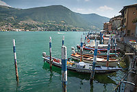 Boat moorings at Peschiera Margalio on Monte Isola, Lake Iseo, Lombardy, Italy.