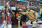 07 APR 2012:  Goalie Parker Milner (35) of Boston College gives his hockey stick to a fan after their victory against Ferris State University during the Division I Men's Ice Hockey Championship held at the Tampa Bay Times Forum in Tampa, FL.  Boston College defeated Ferris State 4-1 to win the national title.  Matt Marriott/NCAA Photos