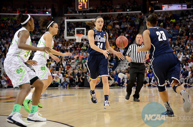 07 APR 2013:  Kelly Faris (34) of the University of Connecticut makes a pass against the University of Notre Dame during the Division I Women's Basketball Championship in New Orleans, LA.  Jamie Schwaberow/NCAA Photos