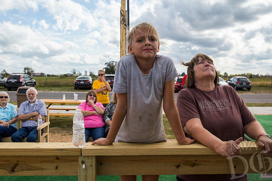 NWA Democrat-Gazette/CHARLIE KAIJO Annelise Bader, 9 of Springdale and Letitia Stain of Yaleville watch sand sculpting on Saturday, October 21, 2017 at Sullivan Square in Bentonville. Four artists started the sand project on Monday that will involved about 275 hours of building time and 280 tons of sand.