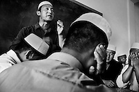 An imam speaks at a small mosque in Pingliang, Gansu, China.