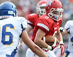 SIOUX FALLS, SD - SEPTEMBER 7:  Trevor Naasz #9 from Lincoln looks to get past Tanner Schulte #16 from O'Gorman in the first quarter of their game at the 2013 Presidents Bowl at Howard Wood Field. (Photo by Dave Eggen/Inertia)