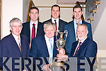 HURLERS: P B McElligott who has'nt missed a Kilmoyley Hurling Social in 46years holds the Neilus Flynn County Championship Cup 2008 for the first time ever: Front l-r: Mark Sullivan (GM Ballyroe), PB McElligott and Sean Murnane (Chairman). Back were: Tom Murnane, Ian and Shane Brick (Kilmoyley Hurlers).........