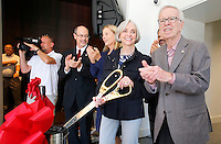 NWA Democrat-Gazette/DAVID GOTTSCHALK  Don Bobbitt (from left), president of the University of Arkansas System, Ronda Mains, chair of the music department, Joyce and Jim Faulkner participate in a ribbon cutting ceremony Friday, September 18, 2015 in the lobby of the new Jim and Joyce Faulkner Performing Arts Center on the campus in Fayetteville. Jim and Joyce Faulkner made a $6 million donation to the university in 2012 specifically toward renovating and remodeling the Field House into a performing arts center.