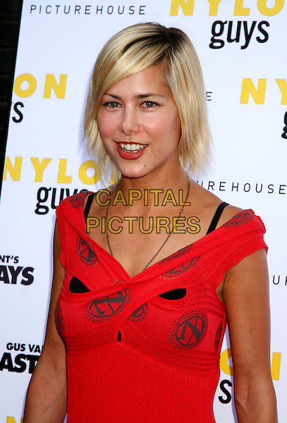 "NICOLE VICIUS.""Last Days""  Premiere at the Sunshine Theater in New York City..July 19th, 2005.half length off the shoulder red criss cross bra strap roots.www.capitalpictures.com.sales@capitalpictures.com.©Capital Pictures"