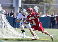 Washington, DC - March 31, 2018: Denver Pioneers Austin French (4) is being defended by a Georgetown Hoyas defender during game between Denver and Georgetown at  Cooper Field in Washington, DC.   (Photo by Elliott Brown/Media Images International)