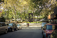 """The Ralph Ellison Memorial on Riverside Drive in Harlem  in New York on Saturday, October 26, 2013. The fifteen-foot high bronze monument to the author was designed by Elizabeth Catlett and represents Ellison's famous novel, """"Invisible Man"""". . (© Richard B. Levine)"""