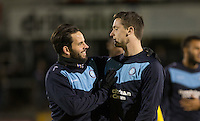 Sam Wood of Wycombe Wanderers enjoys a joke with Stephen McGinn of Wycombe Wanderers during the Sky Bet League 2 rearranged match between Bristol Rovers and Wycombe Wanderers at the Memorial Stadium, Bristol, England on 1 December 2015. Photo by Andy Rowland.
