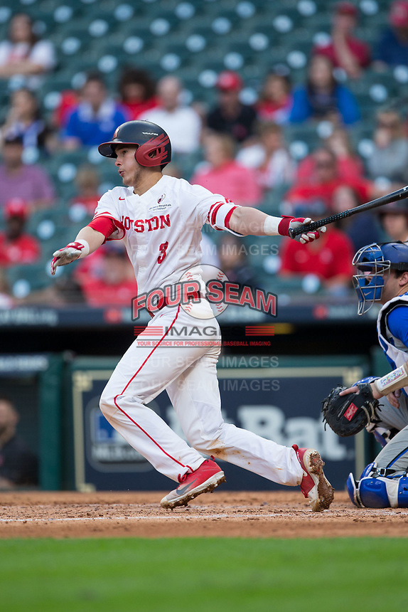 Tucker Redden (3) of the Houston Cougars follows through on his swing against the Kentucky Wildcats in game two of the 2018 Shriners Hospitals for Children College Classic at Minute Maid Park on March 2, 2018 in Houston, Texas.  The Wildcats defeated the Cougars 14-2 in 7 innings.   (Brian Westerholt/Four Seam Images)