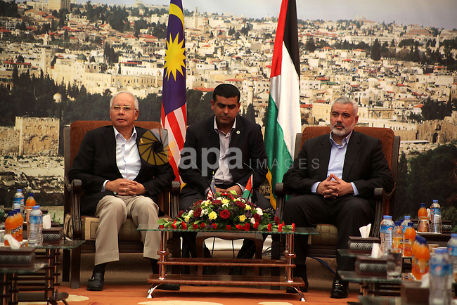 Palestinian Prime Minister Ismail Haniyeh, meets with Malaysian Prime Minister Najib Razak, in Gaza City , Jan. 22, 2013. During his first-ever visit to the territory , Najib Razak is meeting with Hamas politicians, touring sites bombed by Israeli forces and visiting a school funded by his majority-Muslim nation in Southeast Asia. Photo by Ashraf Amra