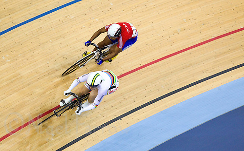 18 FEB 2012 - LONDON, GBR - Australia's Anna Meares (AUS) (bottom left in white) leads Cuba's Lisandra Guerra Rodriguez (CUB) during their Women's Sprint quarter final at the UCI Track Cycling World Cup, and London Prepares test event for the 2012 Olympic Games, in the Olympic Park Velodrome in Stratford, London, Great Britain (PHOTO (C) 2012 NIGEL FARROW)