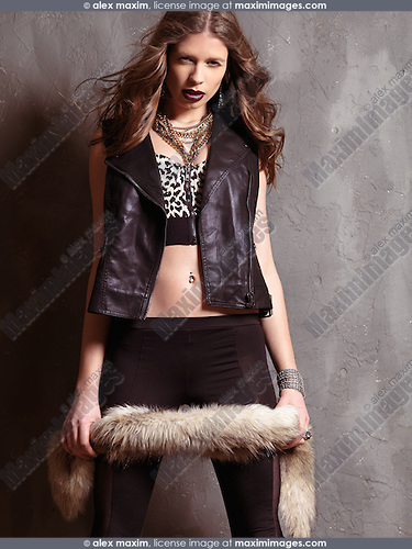 Fashion photo of a young woman wearing grunge fashion style clothing of 90s