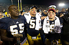 Nov. 17, 2012; Linbackers Prince Shembo, Manti Te'o and wide receiver Robby Toma sing the Alma Mater in front of the student section after defeating Wake Forest 38 to 0. Photo by Barbara Johnston/University of Notre Dame