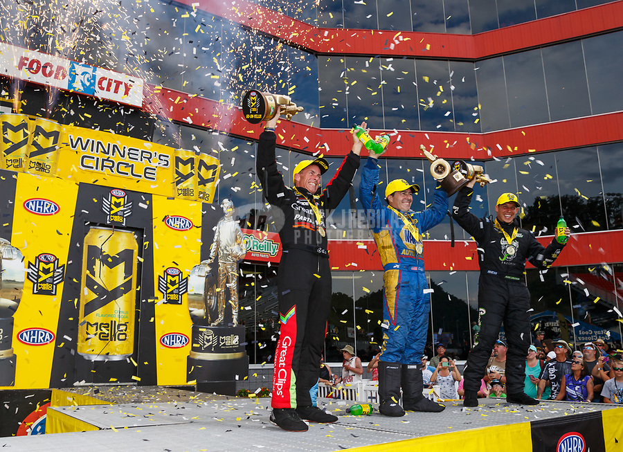 Jun 18, 2017; Bristol, TN, USA; NHRA top fuel driver Clay Millican (left) celebrates alongside funny car driver Ron Capps (center) and pro stock driver Alex Laughlin after winning the Thunder Valley Nationals at Bristol Dragway. Mandatory Credit: Mark J. Rebilas-USA TODAY Sports