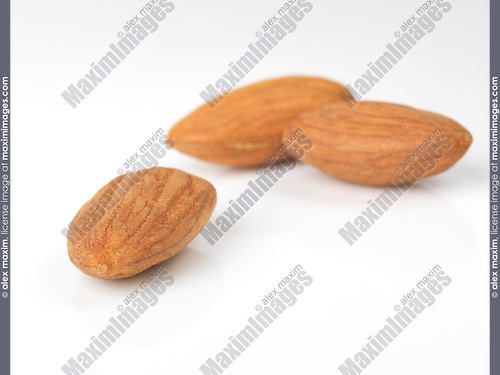 Closeup of almonds, almond seeds, nuts, isolated on white studio background