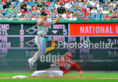24 September 2011: Atlanta Braves second baseman Dan Uggla jumps to get the throw as Danny Espinosa steals second for the Washington Nationals at Nationals Park in Washington, DC. The Nationals defeated the Braves 4-1 to even up their 3-game series. Mandatory Credit: Ed Wolfstein Photo