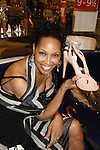 Guiding Light Kim Brockington shows off a pair of Prada shoes she really likes - The Innaugural Celebration of Color on Broadway Awards were held on June 9, 2011 at SAKS Fifth Avenue, New York City, New York. The event was held upstairs where beautiful shoes are sold and where a part of the sales this night will benefit OPUS 118 Harlem's School of Music. (Photo by Sue Coflin/Max Photos)