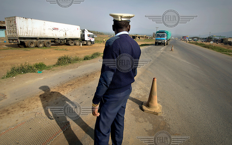 Police checkpoint at a weigh bridge for trucks on route to Uganda and beyond.