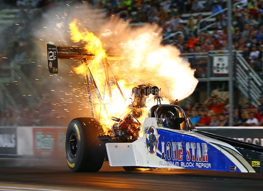 Jun 17, 2016; Bristol, TN, USA; NHRA top fuel driver Terry Haddock explodes an engine on fire during qualifying for the Thunder Valley Nationals at Bristol Dragway. Mandatory Credit: Mark J. Rebilas-USA TODAY Sports