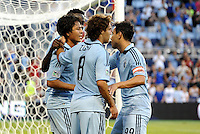 Roger Espinoza (left) celebrates the opening Sporting KC goal with his team mates... Sporting KC defeated Real Salt Lake 2-0 at LIVESTRONG Sporting Park, Kansas City, Kansas.
