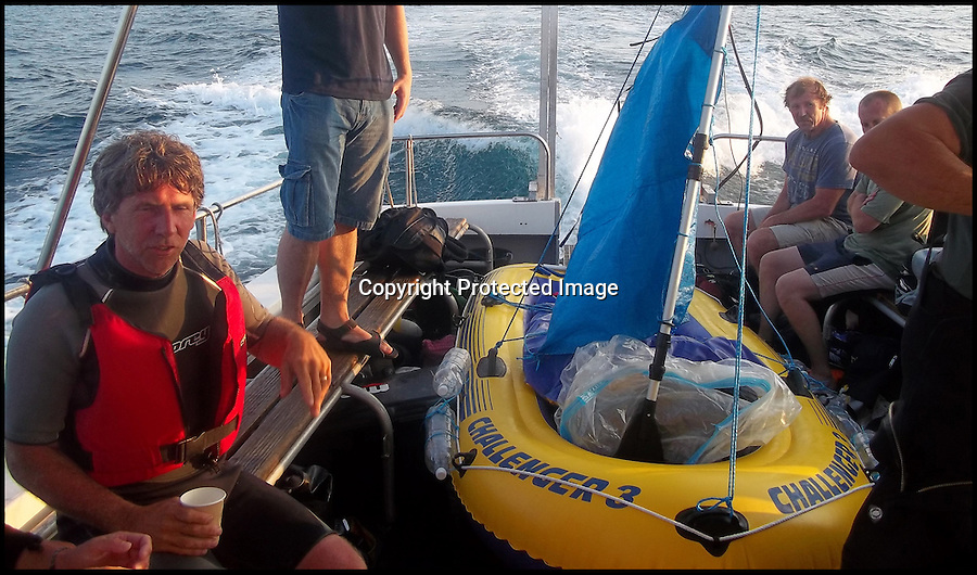BNPS.co.uk (01202 558833)<br /> Pic: LouiseRandall/BNPS<br /> <br /> ***Please use full byline***<br /> <br /> A dive boat had to rescue a Captain Calamity sailor found bobbing around in a six foot rubber dinghy 3 miles off the Dorset coast yesterday.<br /> <br /> The madcap mariner had set off in his unsuitable craft from Osmington beach near Weymouth to attempt a 35 mile voyage to Bournemouth.<br /> <br /> After several hours struggling against the prevailing tide the dive boat 'X-dream' had to come to his rescue.